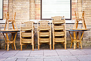 Wicker Chairs Framed Prints - Stacked chairs Framed Print by Tom Gowanlock
