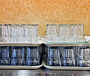 Cafeteria Photo Prints - Stacked Glasses in a Cafeteria Print by David Buffington
