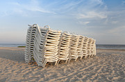 Lounge Prints - Stacked Lounge Chairs on a Beach Print by Jaak Nilson