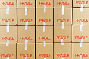 Frame House Prints - Stacks of cardboard boxes marked Fragile Print by Sami Sarkis