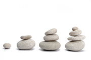 Conformity Photos - Stacks of pebbles on white background by Sami Sarkis