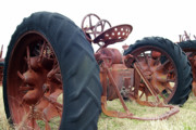 Rusty Tractor Tires Acrylic Prints - Standing Still Acrylic Print by Joy Tudor