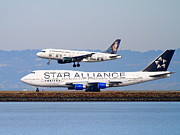 San Francisco Airport Framed Prints - Star Alliance Airlines And Frontier Airlines Jet Airplanes At San Francisco International Airport Framed Print by Wingsdomain Art and Photography