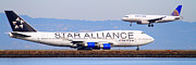Jet Star Photo Prints - Star Alliance Airlines And United Airlines Jet Airplanes At San Francisco Airport SFO . Long Cut Print by Wingsdomain Art and Photography