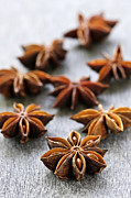 Spices Prints - Star anise fruit and seeds Print by Elena Elisseeva