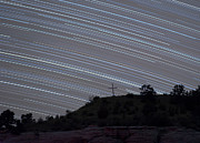 Stars Trail Prints - Star Trails Arch Over A Cross On A Hill Print by John Davis