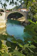Mostar Photos - Stari Most Or Old Town Bridge Over The by Trish Punch