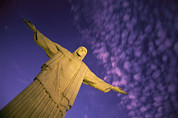 Religious Characters And Scenes Photos - Statue Of Jesus Christ Against Twilight by Michael Melford