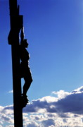 Jesus Christ Icon Posters - Statue of Jesus Christ on the cross against a cloudy sky Poster by Sami Sarkis