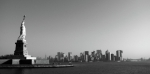 Black And White Photography Photos - Statue Of Liberty Looking Over Manhattan by Anna Grove