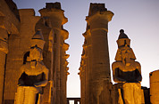 Pharaoh Posters - Statues Of Ramses Ii Rest In The Sunset Poster by Taylor S. Kennedy