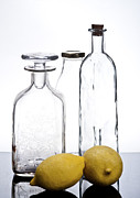 Various Posters - Still life of bottles  and lemons Poster by Ilan Amihai