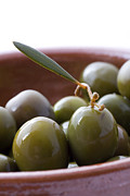 Food And Beverage Acrylic Prints - Still life of Spanish Campo Real olives Acrylic Print by Frank Tschakert
