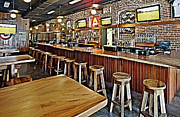 Sports Bar Prints - Stools and Counter in a Sports Bar Print by Skip Nall
