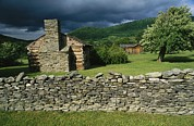 Log Cabins Photo Posters - Storm Clouds Form Above Log Buildings Poster by Raymond Gehman