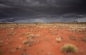 Flooding Photos - Storm Clouds Over Desert by Robbie Shone