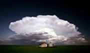 Farm Buildings Prints - Storm clouds over Saskatchewan granaries Print by Mark Duffy