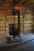 Log Cabin Photographs Framed Prints - Stove in a Cabin Framed Print by Jeff Moose