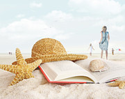 Cord Art - Straw hat  book and seashells in the sand by Sandra Cunningham
