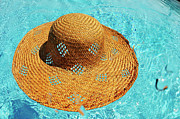 Carefree Photos - Straw hat floating on pool by Sami Sarkis