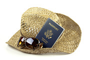 Clothing Posters - Straw hat with glasses and passport Poster by Blink Images