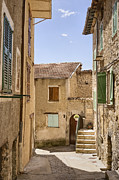 Abandoned Buildings Framed Prints - Street in Medieval French Town Framed Print by Jon Boyes