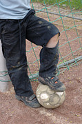 Ball Game Prints - Street soccer - torn trousers and ball Print by Matthias Hauser