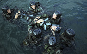 Navy Seals Posters - Students Secure A Simulated Casualty Poster by Stocktrek Images