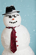 Attitude Photos - Studio Shot Of Snowman Dressed As Businessman by Tetra Images