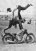 Personal Land Vehicle Framed Prints - Stuntmen Framed Print by Fox Photos