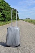 Getting Away Prints - Suitcase on empty countryside road Print by Sami Sarkis