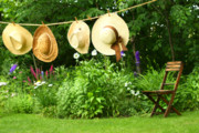 Hat Digital Art - Summer straw hats hanging on clothesline by Sandra Cunningham