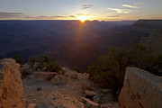 Sun Rise Prints - Sun peaks over the horizon at the Grand Canyon Print by Sven Brogren