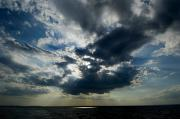 Long Island Sound Posters - Sun Rays Through Clouds Form A Spot Poster by Todd Gipstein