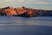 Crater Lake Prints - Sun rising at Crater Lake National Park Print by Pierre Leclerc