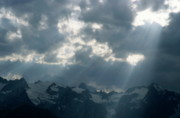 Barre Prints - Sunbeams playing over the Barre des Ecrins and La Meije mountains in the French Alps Print by Sami Sarkis