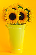 Flower Blooming Photos - Sunflowers in vase by Elena Elisseeva