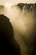 Zambia Waterfall Photos - Sunlight Illuminates Mist Rising by Ralph Lee Hopkins