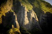 Marquesas Islands Prints - Sunlight Shines On Rock Formations Print by Tim Laman