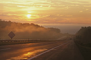 Road Signs Prints - Sunrise Along A Highway On A Foggy Print by Wolcott Henry