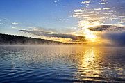 Sunrise  Posters - Sunrise on foggy lake Poster by Elena Elisseeva