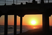 Lighthouse At Sunrise Posters - Sunset at Huntington Beach Pier Poster by Mariola Bitner