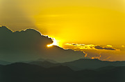 Brightly Lit Prints - Sunset behind mountains Print by Ulrich Schade