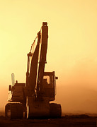 Soft Framed Prints - Sunset Excavator Framed Print by Olivier Le Queinec