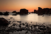 Silk Water Prints - Sunset on a rock Print by Keith Kapple