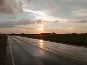 Sunset After A Storm Framed Prints - Sunset on Shiny Highway Framed Print by Brian  Maloney
