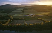 River Scenes Posters - Sunset Over A Farm On The Susquehanna Poster by Raymond Gehman