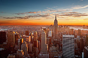 Building Prints - Sunset Over Manhattan Print by Inigo Cia
