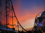 Roller Coaster Posters - Sunset Over Roller Coaster Poster by Eena Bo