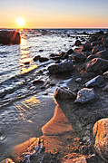 Shoreline Photos - Sunset over water by Elena Elisseeva